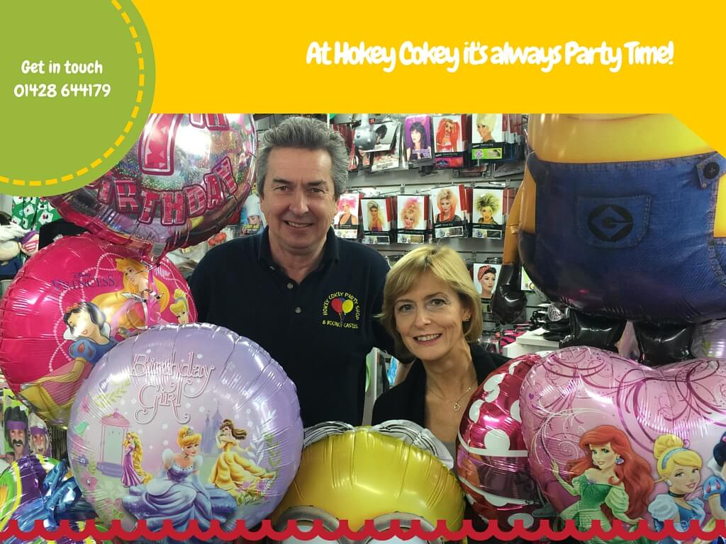 Julie and Tim surrounded by Balloons in the Hokey Cokey Party Shop