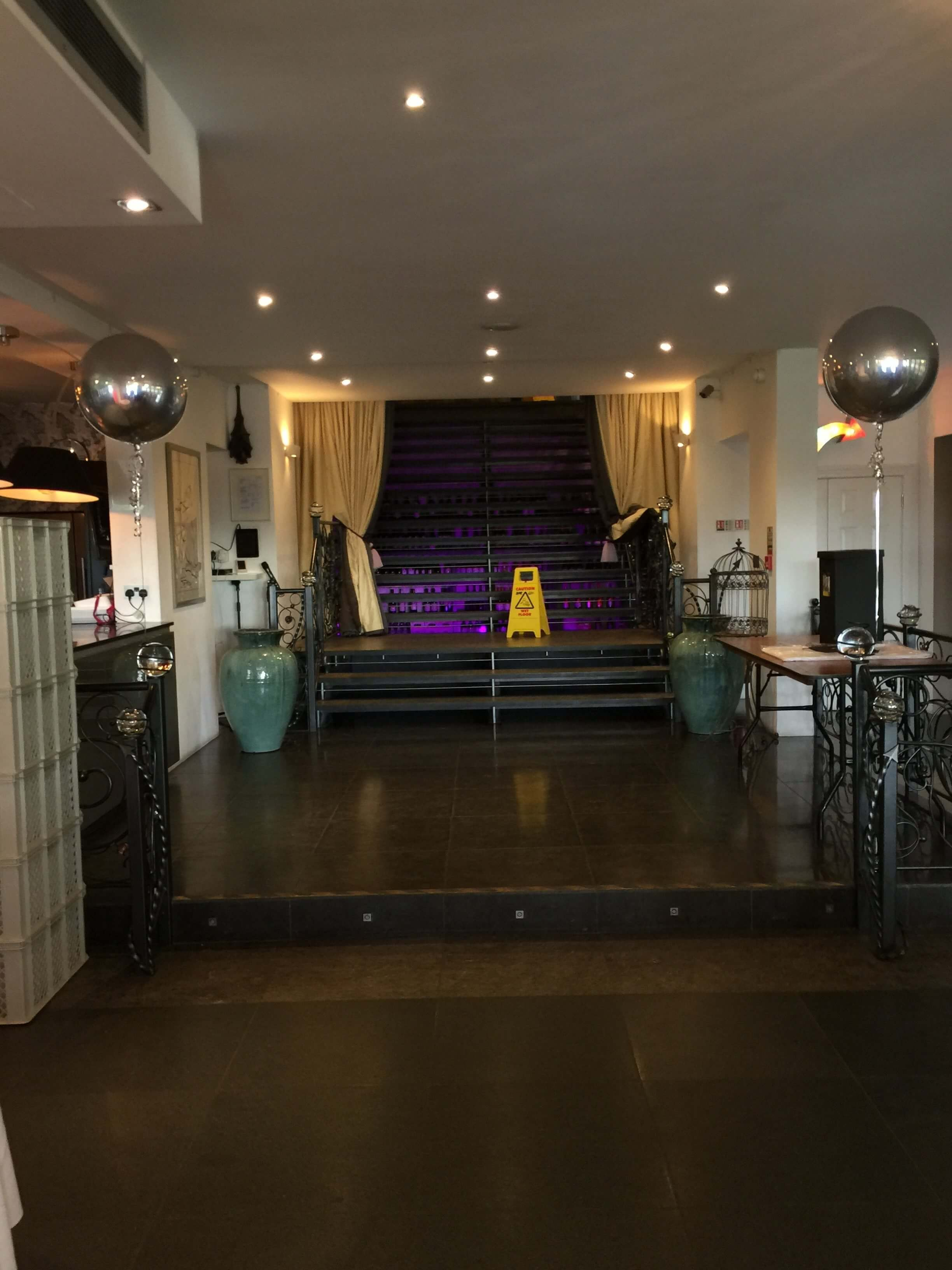 Silver Round Orbz Balloons at a Wedding Venue